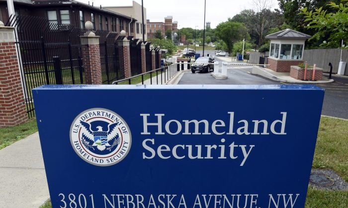 In this June 5, 2015, file photo, a gate leading to the Homeland Security Department headquarters in northwest Washington. (AP Photo/Susan Walsh, File)