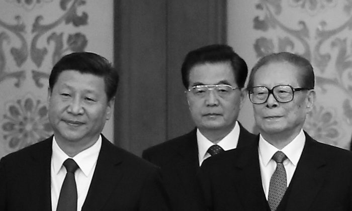 Chinese President Xi Jinping and his predecessors Hu Jintao and Jiang Zemin arrive for the National Day reception marking the 65th anniversary of the founding of the People's Republic of China at The Great Hall Of The People on September 30, 2014 in Beijing, China.  (Feng Li/Getty Images)