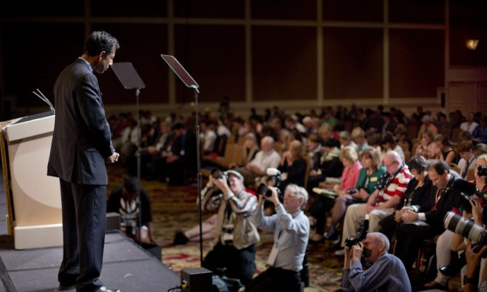 Louisiana Gov. Bobby Jindal bows his head on stage as he leads a prayer for the victims of Charleston church shooting before speaking at the Road to Majority 2015 convention in Washington, Friday, June 19, 2015.