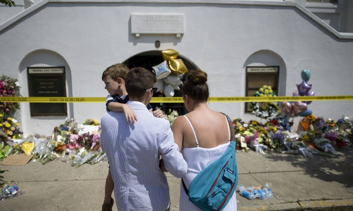 People visit a memorial outside the Emanuel AME Church June 19, 2015 in Charleston, South Carolina. (Brendan Smialowski/AFP/Getty Images)