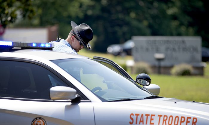 A trooper stands near the scene where one person was shot at a Georgia State Patrol post Monday, June 8, 2015, in Gainesville, Ga. (AP Photo/David Goldman)