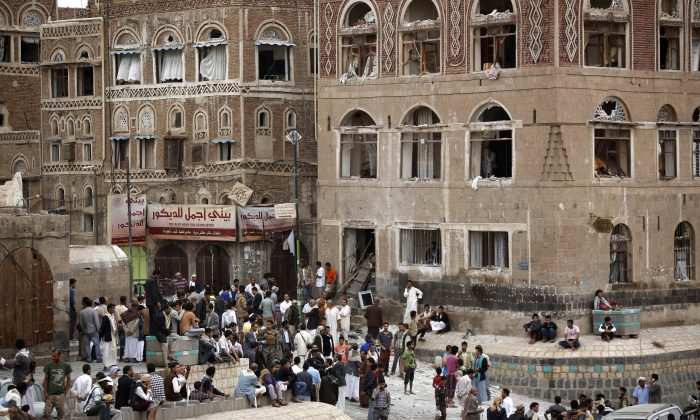 People gather  at the site of an explosion near the old city of Sanaa, Yemen, Saturday, June 20, 2015. (AP Photo/Hani Mohammed)