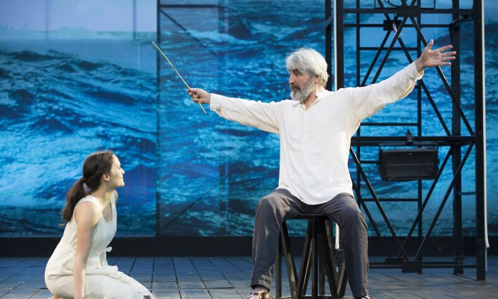 "Miranda (Francesca Carpanini) listens to her father, Prospero (Sam Waterston), the master of the island, in ""The Tempest."" The Public Theater Free Shakespeare in the Park production was directed by Michael Greif.  (Joan Marcus)"