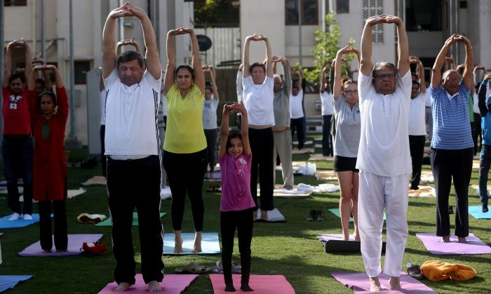 Afghans and foreigners perform ypga during the first International Yoga Day, at the Indian Embassy in Kabul, Afghanistan, Sunday, June 21, 2015. Thousands of yoga enthusiasts took part in mass yoga programs to mark the first International Yoga Day throughout the world. (AP Photo/Massoud Hossaini)
