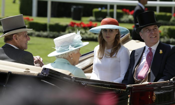 Princes Beatrice, 2nd right, with her father Prince Andrew, right, share the same carriage as Britain's Queen Elizabeth II and Prince Philip as they arrive in the parade ring on the third day of the Royal Ascot horse racing meet at Ascot, England, Thursday, June 18, 2015. (AP Photo/Alastair Grant)