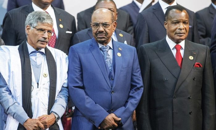Sudanese President Omar al-Bashir (C), Congo's President Denis Sasso-Nguesso (R) and Prime Minister of the Sahrawi Arab Democratic Republic Abdelkader Taleb Oumar (L) at the 25th African Union Summit in Sandton, South Africa, on June 14. (Gianluigi Guercia/AFP/Getty Images)