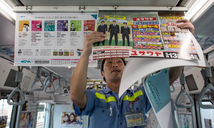 Okami Yuji replaces advertisements inside a subway train May 15 in Tokyo. Selecting the right marketing platform and the right pricing structure make a huge difference in determining the success of a campaign. (Chris McGrath/Getty Images)