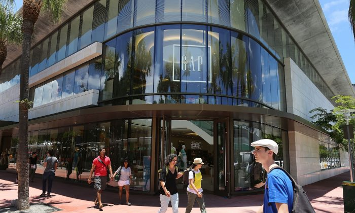 People walk past a store in Miami Beach, Fla., on June 16, 2015. (Joe Raedle/Getty Images)