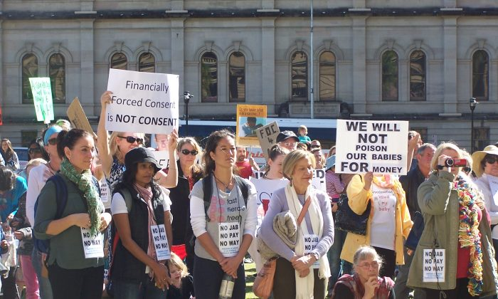 Supporters with banners at NO JAB, NO PAY, NO WAY rally at Queens Square, Brisbane on June 22, 2015. (Laurel Andress/Epoch Times)