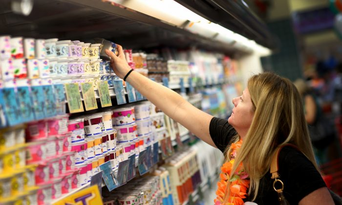 A customer shops for yogurt during the grand opening of a Trader Joe's on October 18, 2013 in Pinecrest, Florida. (Joe Raedle/Getty Images)