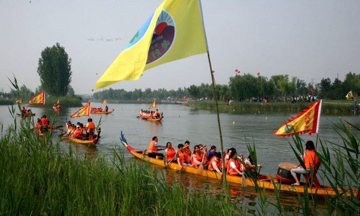 This picture taken on June 20, 2015 shows dragon boats setting off on the annual race along a river in Binzhou, northeast China's Shandong province.  Dragon boat racing dates back over 2,000 years and has now developed into a serious sport on the calendar of many countries around the world. (STR/AFP/Getty Images)