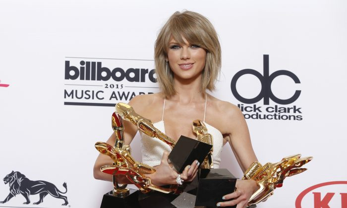 "Taylor Swift poses in the press room with the awards for top Billboard 200 album for ""1989"", top female artist, chart achievement, top artist, top Billboard 200 artist, top hot 100 artist, top digital song artist, and top streaming song (video) for ""Shake It Off"" at the Billboard Music Awards at the MGM Grand Garden Arena, in Las Vegas. (Photo by Eric Jamison/AP)"