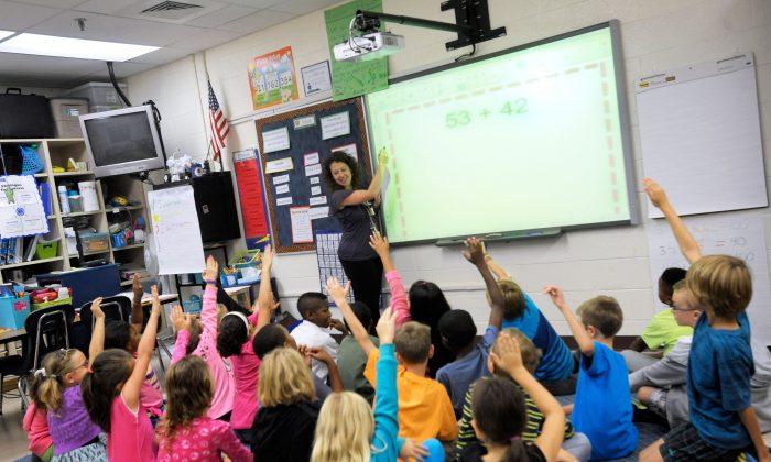 Third grade teacher Melissa Grieshober teaches a math lesson at Silver Lake Elementary School in Middletown, Del., on Oct. 1, 2013. (AP Photo/Steve Ruark)