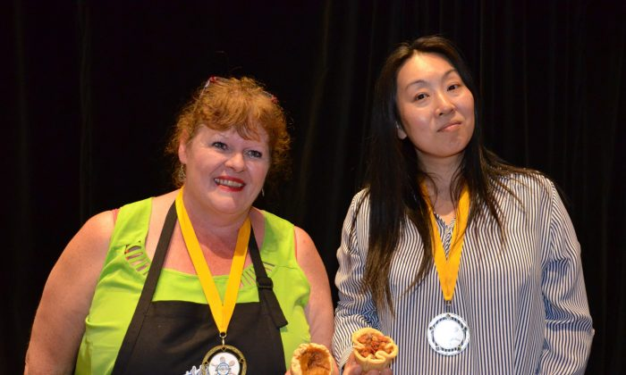 Winners of the Best Butter Tart Festival and Contest are Diane Rogers of Doo Doo's Bakery in Balieborough (L), who won in the professional division with her pumpkin butter tart, and Hisako Niimi of Ottawa who took first place in the home division with her banana-bacon-peanut butter entry. (Parm Parmar)