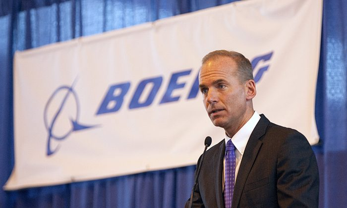 Boeing Chairman and CEO Dennis Muilenburg speaks during a ceremony at MidAmerica Airport in Mascoutah, Ill. in 2010. (Tim Vizer/Belleville News-Democrat via AP)