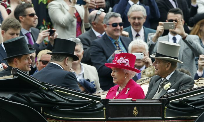 Britain's Queen Elizabeth II arriving with Prince Philip, the Duke of Edinburgh and Prince Harry for the first day of Royal Ascot horse racing meet at Ascot, England. The queen is planning to leave Tuesday, June 23, 2015, on a state visit to Germany that will include her first visit to a former concentration camp site. She and her husband Prince Philip plan to visit the Bergen-Belsen camp where diarist Anne Frank and her sister Margot died just weeks before the British liberated it on April 15, 1945. (AP/Alastair Grant)
