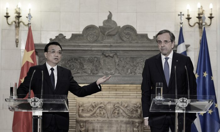 Chinese Prime Minister Li Keqiang (L) and Greek Prime Minister Antonis Samaras take part in a joint press conference at the Maximos Mansion in Athens after a meeting, on June 19, 2014. (Louisa GouliamakiAFP/Getty Images)