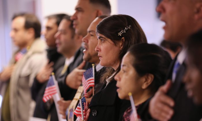 Immigrants take oath of citizenship to the United States on November 20, 2014 in Newark, New Jersey. (John Moore/Getty Images)