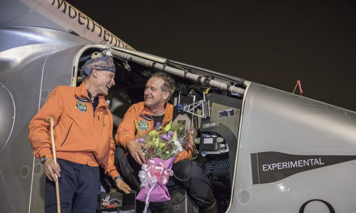 Pilots Andre Boschberg (R), and Bertrant Piccard talk after Solar Impulse 2, a solar-powered airplane, finished up the first day of an historic round-the-world journey that began in Abu Dhabi, UAE, on March 09, 2015  in Muscat, Oman.  (Jean Revillard via Getty Images)