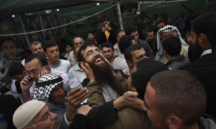 Palestinian Khader Adnan, center, is greeted by Palestinians during a celebration ceremony after his release from Israeli jails (AP/Bernat Armangue,)