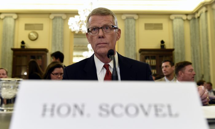 Department of Transportation Inspector General Calvin L. Scovel III, as waits to testify before the Senate Commerce, Science, and Transportation Committee on Capitol Hill in Washington, Tuesday, June 23, 2015, for a hearing on faulty Takata airbags. (AP Photo/Susan Walsh)