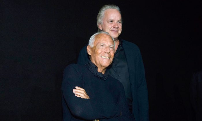 Giorgio Armani (Front) and actor Tim Robbins greets the audience after presenting the Emporio Armani Spring/Summer 2016 men's fashion collection, in Milan on June 20, 2015. (AP Photo/Giuseppe Aresu)