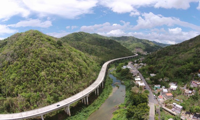 This June 11, 2015 aerial photo shows the dry banks of La Plata River in Comerio, in central Puerto Rico. (AP Photo/Ricardo Arduengo)