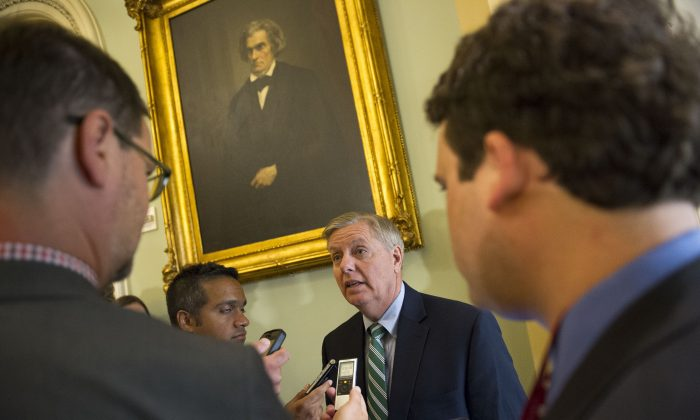 Sen. Lindsey Graham, R-S.C., speaks with reporters before attending a policy luncheon at the U.S. Capitol in Washington, Tuesday, June 23, 2015. The Senate pushed bipartisan trade legislation to the brink of final approval Tuesday in a combined effort by President Barack Obama and Republican congressional leaders to rescue a measure that appeared all but dead less than two weeks ago. (AP/Cliff Owen)