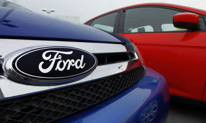 FILE - This July 1, 2012 file photo shows the Ford logo on a vehicle at a Ford dealership in Springfield, Ill. (AP Photo/Seth Perlman, File)