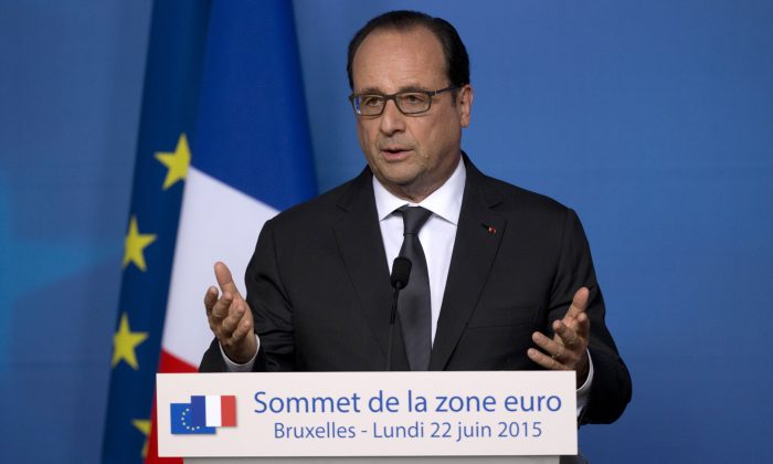 French President Francois Hollande speaks during a media conference at an EU summit in Brussels. WikiLeaks published documents late Tuesday, June 23, 2015, that it says show the U.S. National Security Agency eavesdropped on the last three French presidents, Hollande, Nicolas Sarkozy and Jacques Chirac, releasing material which appeared to capture officials in Paris talking candidly about Greece's economy, relations with Germany — and, ironically, American espionage. (AP/Michel Euler)