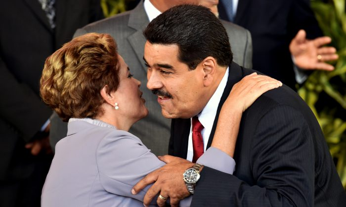 Brazilian President Dilma Rousseff (L) greets Venezuelan President Nicolás Maduro during the III CELAC Summit 2015, in Costa Rica, on Jan. 28. (Rodrigo Arangua/AFP/Getty Images)