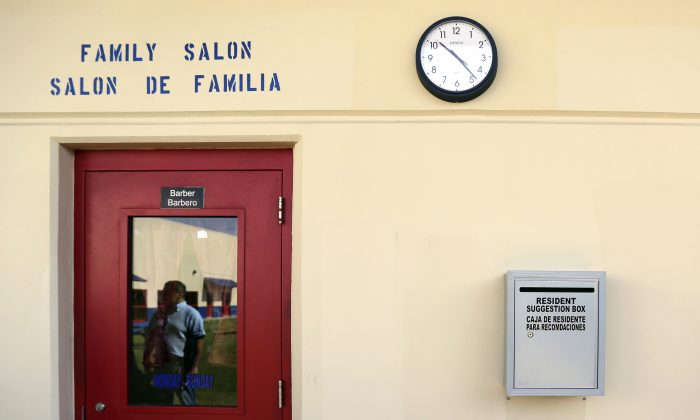 FILE - In this July 31, 2014 file photo, a suggestion box hangs on the wall outside of the hair salon at the Karnes County Residential Center, in Karnes City, Texas. (AP Photo/Eric Gay, File)