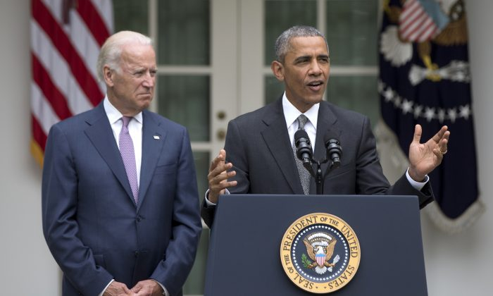 President Barack Obama, accompanied by Vice President Joe Biden, speaks in the Rose Garden of the White House, Thursday, June 25, 2015, in Washington, after the U.S. Supreme Court upheld the subsidies for customers in states that do not operate their own exchanges under President Barack Obama's Affordable Care Act. (AP Photo/Carolyn Kaster)