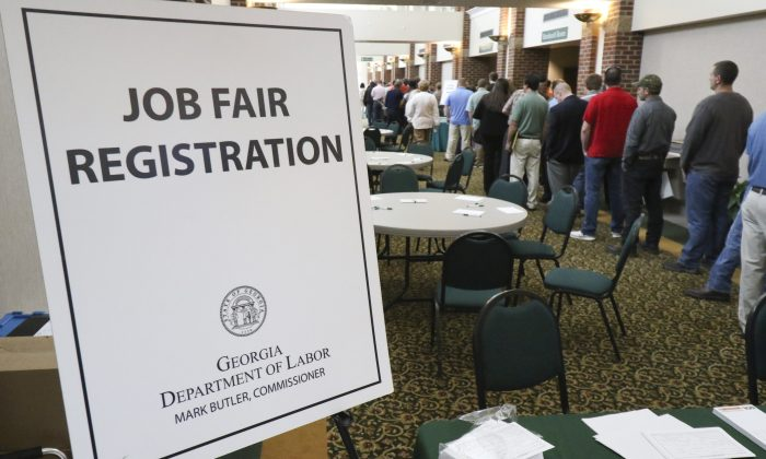 In this April 2, 2015, photo, a crowd gathers for a huge 15-county job fair at The Colonnade in Ringgold, Ga. (Dan Henry/Chattanooga Times Free Press via AP)