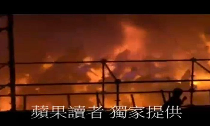 In this screen grab taken from UGC by Apple Daily Taiwan, concert goers run as a fire starts at the Formosa Water Park in New Taipei City, Taiwan, on June 27, 2015. (UCG by Apple Daily Taiwan via AP)