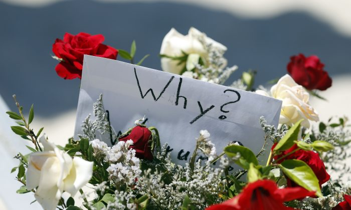 Flowers at the scene of the shooting in Sousse, Tunisia, Saturday, June 27, 2015. The morning after a lone gunman killed tens of people at a beach resort in Tunisia, busloads of tourists are heading to the nearby Enfidha-Hammamet airport hoping to return to their home countries. (AP Photo/Darko Vojinovic)