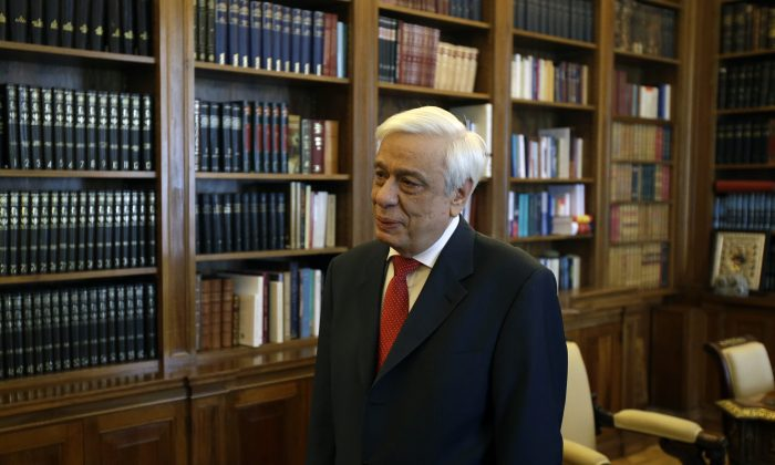 Greece's President Prokopis Pavlopoulos waits for former Prime Minister and head of the main opposition New Democracy party, Antonis Samaras at Presidential Palace in Athens, Sunday, June 28, 2015.  Greece is anxiously awaiting a decision by the European Central Bank on whether to increase the emergency liquidity assistance banks can draw on from the country's central bank. (AP Photo/Thanassis Stavrakis)