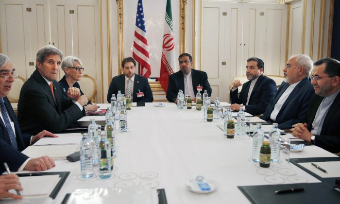 From left, U.S. Secretary of Energy Ernest Moniz, U.S. Secretary of State John Kerry and U.S. Under Secretary for Political Affairs Wendy Sherman, attend a meeting with Iranian Foreign Minister Mohammad Javad Zarif, second from right, at a hotel in Vienna, Austria, Sunday, June 28, 2015. After two years of high-pressure gatherings, a sense of predictability emerged in the negotiations between Kerry and Zarif. (Carlos Barria/Pool Photo via AP)