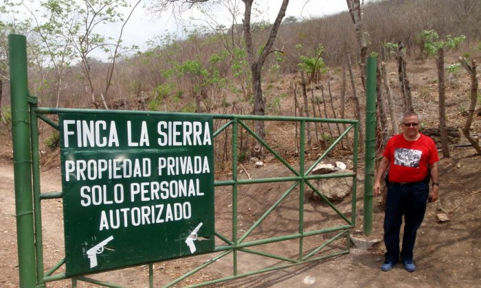Fundacion Turcios Lima President Cesar Montes at gate established to keep people from access to public domain and the protected biosphere forest of Sierra de las Minas. (John Christopher Fine copyright 2015)