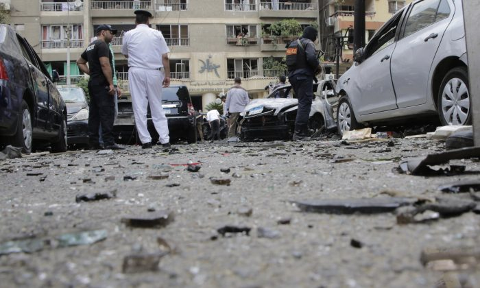 Egyptian security personnel stand guard after a bomb attack that targeted Egypt's prosecutor general in the Heliopolis district of Cairo, Egypt, Monday, June 29, 2015. (AP Photo/Amr Nabil)