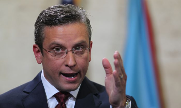 In this April 30, 2015, photo, Puerto Rico Gov. Alejandro Garcia Padilla delivers his budget address for the next fiscal year at the Capitol building in San Juan. Puerto Rico's governor believes the U.S. territory's $72 billion public debt is unpayable, his spokesman confirmed late Sunday, June 28, 2015. (AP Photo/Ricardo Arduengo)