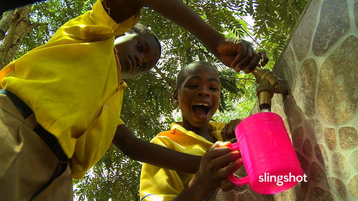 boys getting water in Slingshot