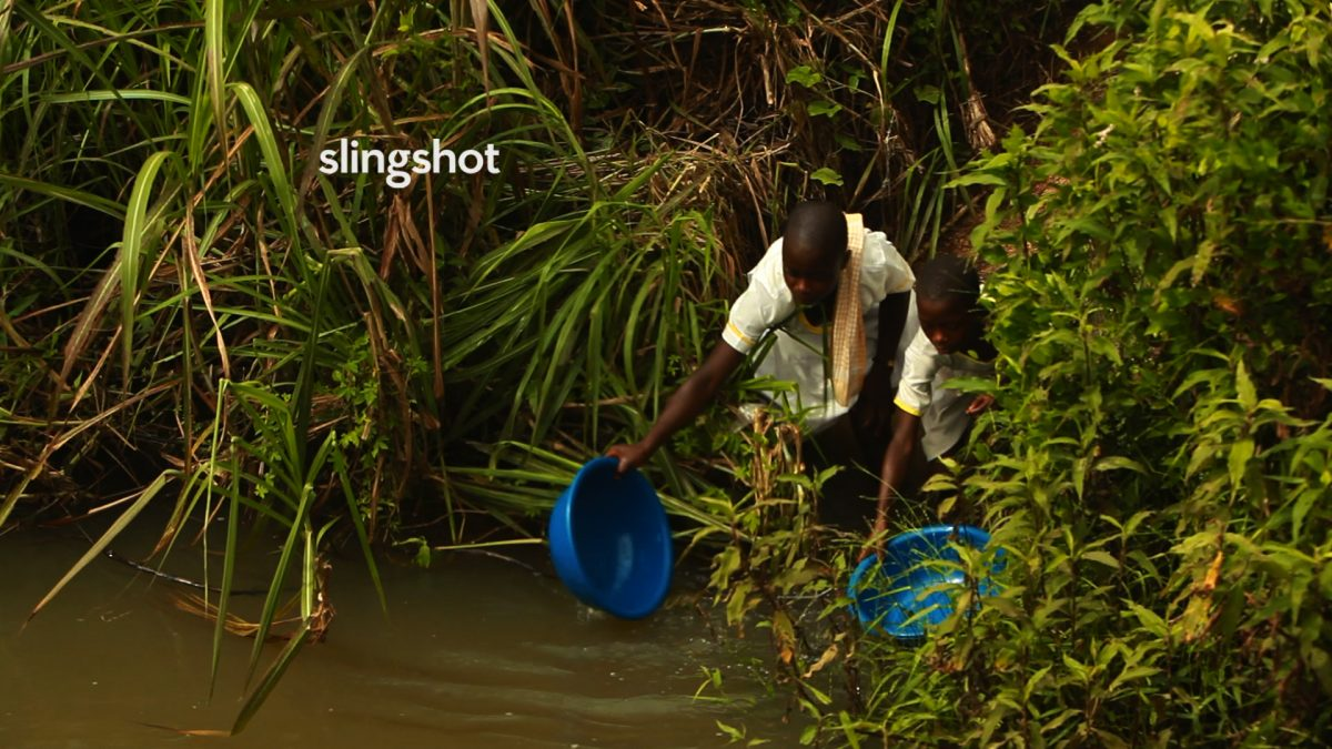 african girl scooping water from river in Slingshot