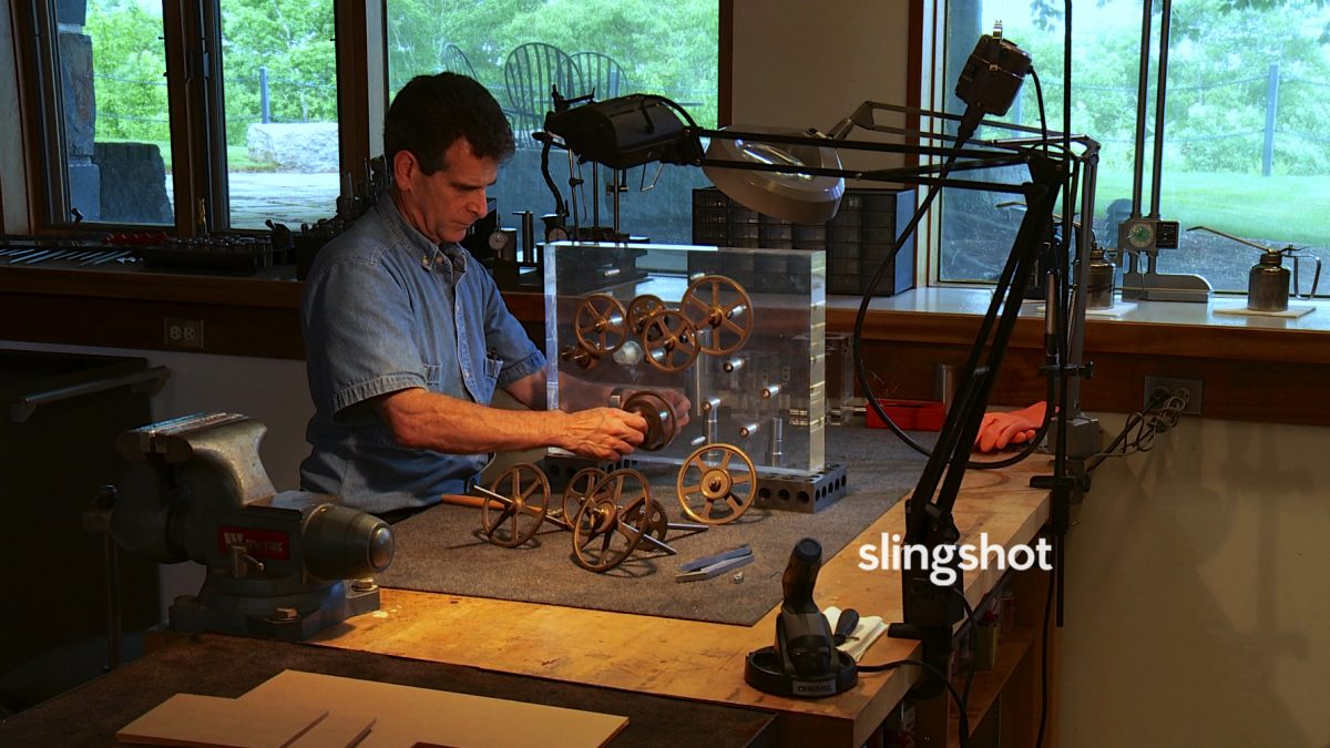 man with clock in Slingshot
