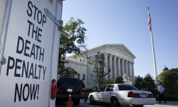 "A vehicle parked near the Supreme Court in Washington, has signage that says ""Stop The Death Penalty Now,"" Monday June 29, 2015.  (AP Photo/Jacquelyn Martin)"
