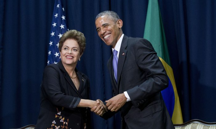 In this April 11, 2015, file photo, U.S. President Barack Obama, right, and Brazilian President Dilma Vana Rousseff shake hands during their bilateral meeting at the Summit of the Americas in Panama City, Panama. (AP Photo/Pablo Martinez Monsivais, File)