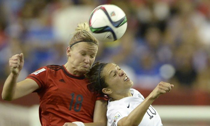 Germany's Alexandra Popp (18) and USA's Carli Lloyd (10) battle for a header in Women's World Cup semifinal action in Montreal on June 30, 2015. (The Canadian Press/Ryan Remiorz)
