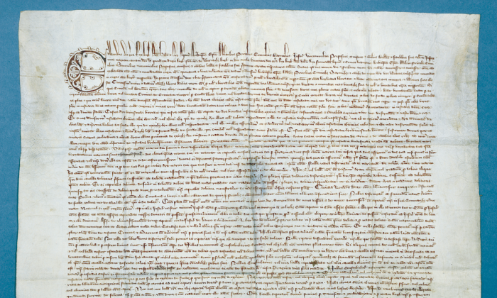"""The 1300 Magna Carta, written on parchment, begins with a decorated initial """"E"""" (for Edward I or Edward Longshanks, son of Henry III). (Chapter of Durham Cathedral)"""