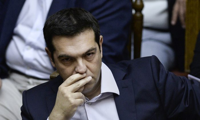 Greek Prime Minister Alexis Tsipras attends a parliamentary session in Athens on June 27, 2015. Greece will hold a referendum on July 5 on the outcome of negotiations with its international creditors taking place in Brussels on June 27, PM Alexis Tsipras announced. (Angelos Tzortzinis/AFP/Getty Images)