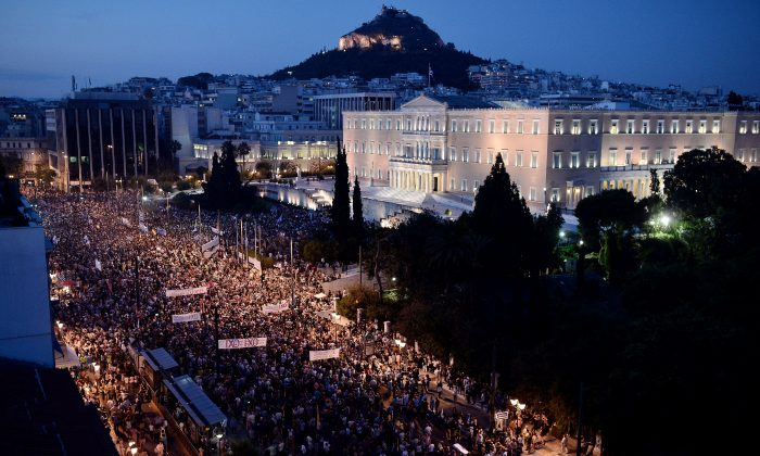 Carrying banners calling for a 'NO' vote in the forthcoming referendum on bailout conditions set by the country's creditors, protesters gather in front of the Greek parliament in Athens, on June 29, 2015. Some 17,000 people took to the streets of Athens and Thessalonique to say 'No' to the latest offer of a bailout deal Monday, accusing Greece's international creditors of blackmail. (Louisa Gouliamaki/AFP/Getty Images)